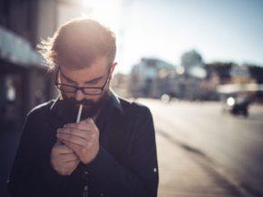 Man lighting cigarette. 9 habits that could make IBD worse, Crohn's, ulcerative colitis, inflammatory bowel disease, UC.