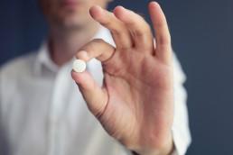 patient holding a xeljanz pill